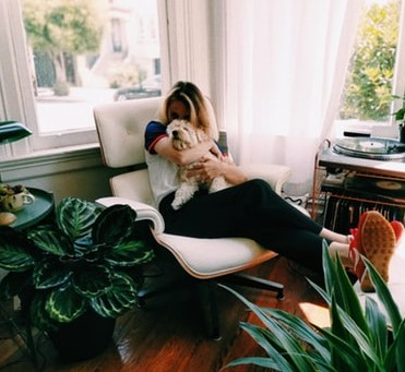Woman In Apartment Dog